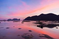 Phi-Phi Lee island in colorful romantic sunset. - stock photo