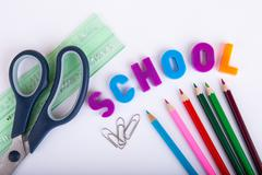 School stationery on white background - stock photo
