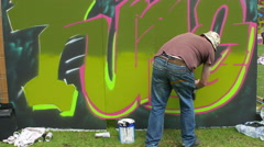 Upfest 2015 in Bristol: Graffiti artist painting on the wall Stock Footage