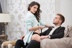Sexy brunette seduced a guy in business suit Stock Photos