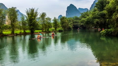 Tourists take bamboo raft floating down river,Guilin,China Stock Footage