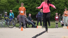 Rollerskater woman in onefoot slalom competition. 4K Stock Footage