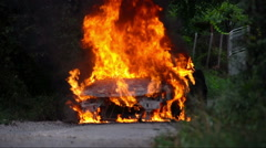 Burning Car. Totally burned car action. Stock Footage