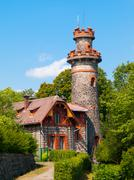 Fairytale house with tower - stock photo