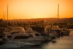 Luxurious yachts docked at the pier - stock photo