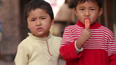 Uyghur boys, Kashgar Old Town, China Stock Footage
