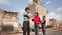 Uyghur boys playing, Kashgar, China Stock Footage