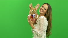 Sexy young girl dancing with a basket with Easter bunny - stock footage