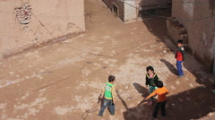 Uighur boys playing tag, Kashgar Old Town Stock Footage