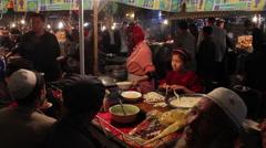 Making noodles, Kashgar night market, China Stock Footage