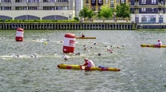 Time lapse view of female swimmers and kayakers at the London Triathlon  Stock Footage