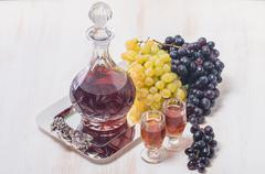 Cristal glasses and a carafe of liquor - stock photo
