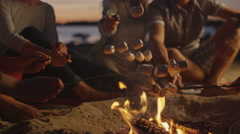 Group of People near Campfire Frying Marshmallows at Night Stock Footage