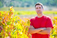 Harvester winemaker farmer proud of his vineyard - stock photo