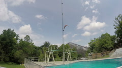 Dive from high dive platform Stock Footage