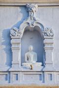 Buddha statue at Ruwanwelisaya stupa in Anuradhapura, Sri Lanka. Stock Photos