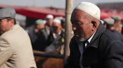 Uyghur man, Kashgar Livestock market, China Stock Footage