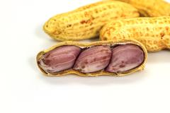 Dried peanuts in closeup Stock Photos