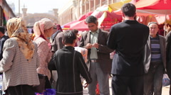 Uighur people in Kashgar Grand Bazaar, China Stock Footage