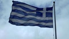 Greek flag waving in slowmotion against moody dramatic sky and clouds Stock Footage
