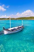 Menorca Es Grau clean port with llaut boats in Balearics - stock photo