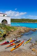 Menorca Es Grau kayak adventure in Balearic Islands - stock photo