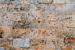 Menorca castle stonewall ashlar masonry wall texture - stock photo