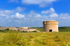 Menorca La Mola watchtower tower Cala Teulera in Mahon - stock photo