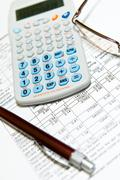 Economic financial research with calculator Stock Photos