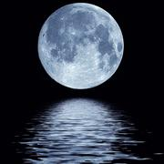 Full moon over water - stock photo