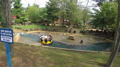 Water ride at theme park Stock Footage
