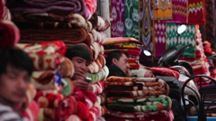 Carpet merchants Kashgar Grand Bazaar, China Stock Footage