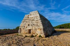 Menorca Ciutadella Naveta des Tudons megalithic tomb - stock photo
