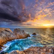Menorca Punta Nati sunset in Balearic Islands - stock photo