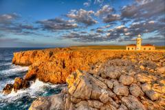 Menorca Punta Nati Faro lighthouse Balearic Islands - stock photo