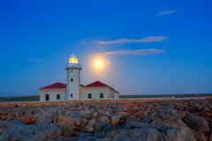 Ciutadella Menorca Punta Nati lighthouse moon shine Stock Photos