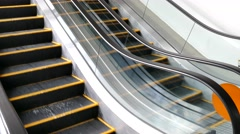 escalators are moving  that constantly run upstairs. - stock footage