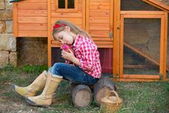 Breeder hens kid girl rancher farmer with chicks in chicken coop Stock Photos