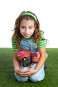 Breeder hens kid girl rancher farmer hug chicken chick Stock Photos