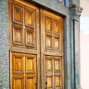Old door in italy land europe architecture and wood the historical gate Stock Photos