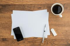 Smart Phone, paper, Eraser and Mechanical pencil with coffee - stock photo