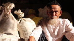 Old Uighur man with beard, Xinjiang, China Stock Footage