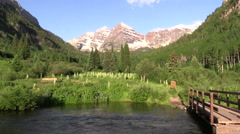 Hiker at Maroon Bells Scenic Landscape Aspen Colorado Stock Footage