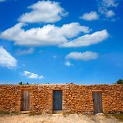 Stock Photo of Formentera Cala Saona beach masonry fishermen houses