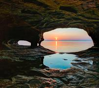 Stock Photo of Secluded Sea Cave Sundown