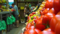 Fresh fruit and vegetable shop - stall of tomatoes zoom out on shop & customers Stock Footage