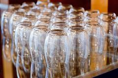 empty water glasses line for coffee break function - stock photo