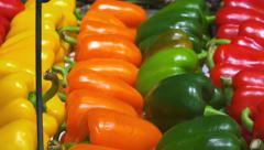 Bell peppers, sweat peppers (red, green, orange, yellow) in a shop - close up Stock Footage