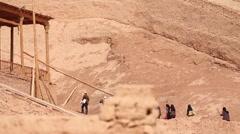 Uyghur muslims in desert village, China - stock footage