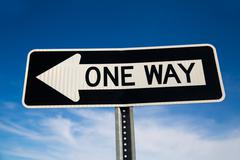 One way arrow sign in USA - stock photo